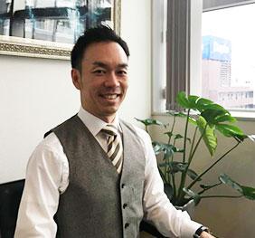写真:三和ホールディングス株式会社 代表取締役社長 石井清悟